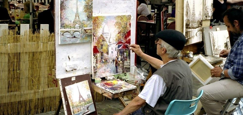 Artistas callejeros en el Barrio de Montmartre durante el tour