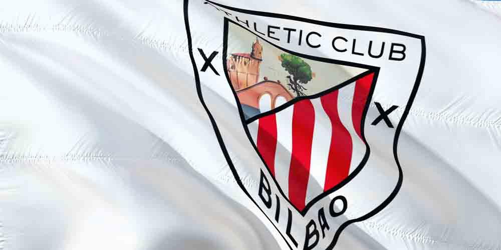 El escudo del Athletic Club de Bilbao con el monumento dibujado de la Iglesia de San Antón.