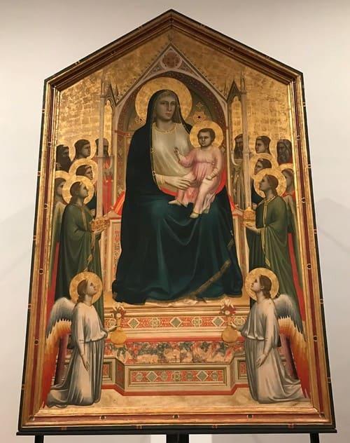 Madonna col Bambino in trono, angeli e santi. Obra de Giotto.